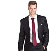 Smiling young businessman - isolated on white background and muc — Stock Photo