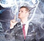 Businessman with smoking gun finge — Stock Photo