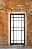 Door in old brick wall — Stock Photo