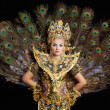 Dancer in a golden dress with peacock feathers — Stock Photo