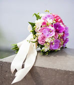 Bridal bouquet with lilac roses and orchids — Stock Photo
