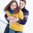 Portrait of happy couple in winter clothes looking at camera — Stock Photo