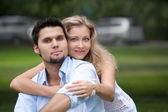 Portrait of beautiful young couple looking at the camera — Stock Photo