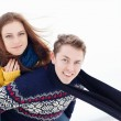 Portrait of a young happy couple in colored sweaters — Stock Photo
