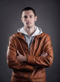 Portrait of a good looking man in classic leather jacket — Стоковое фото