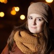 Portrait of a girl in a scarf on the background of night city — Stock Photo