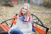 Pretty blond girl in a striped scarf — Stockfoto