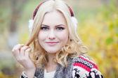 Pretty blonde girl in fur headphones, close-up — Stock Photo