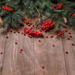Christmas fir tree  branches on a wooden board — ストック写真