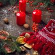 Christmas candles and fir tree  branches on a wooden background — Stok fotoğraf