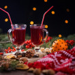 Fir branches, two glasses of mulled wine on a wooden table — Stok fotoğraf