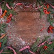Christmas fir tree, ribbons and berrieson rowan on a  wooden board — Stock Photo