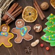 Christmas homemade gingerbread cookie and spices on wooden table. Close-up. — Stock Photo