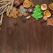 Christmas homemade gingerbread cookie and spices on wooden table. Space for text. — Стоковая фотография
