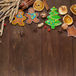 Christmas homemade gingerbread cookie and spices on wooden table. Space for text. — Stock Photo #36571847