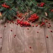 Christmas fir tree  branches on a wooden board — Stock Photo