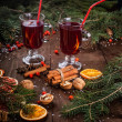Fir branches, two glasses of mulled wine on a wooden table — Stock Photo