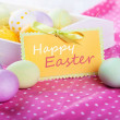 Easter eggs on a pink tablecloth, closeup. Space for text — Stock Photo
