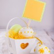 Colorful easter eggs in a decorative basket on wooden background — Stock Photo #39633581