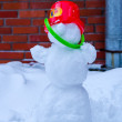 Snowman with red cap — Stock Photo