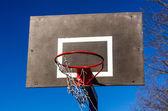 Basketball backboard on blue sky background — Stock Photo