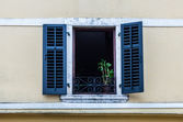 Window with louvers in old house — Stock Photo