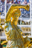 Gold statue in Peterhof — Stock Photo