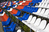 Some rows of colored chairs on a stadium — Stock Photo