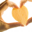 Peace of heart shaped cheese hand holding isolated on white — Stock Photo
