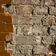 Glased tiles and old bricks wall partly damaged — Stock Photo