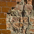 Stock Photo: Glased tiles and old bricks wall partly damaged