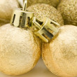 Stock Photo: Golden Christmas baubles, stars, bell and ribbon