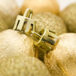 图库照片: Golden Christmas baubles, stars, bell and ribbon