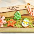 Christmas Ginger cookies in a wooden box and straw background — Foto Stock