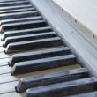Old anticque piano painted in white colour and its keys — Stock Photo