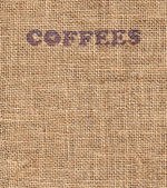 Close up of textured woven hessian fabric with the word Coffee stamped on it in a coffee background concept — Stock Photo