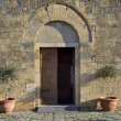 The entrance of Santa Maria Church (Monteriggioni) - ストック写真