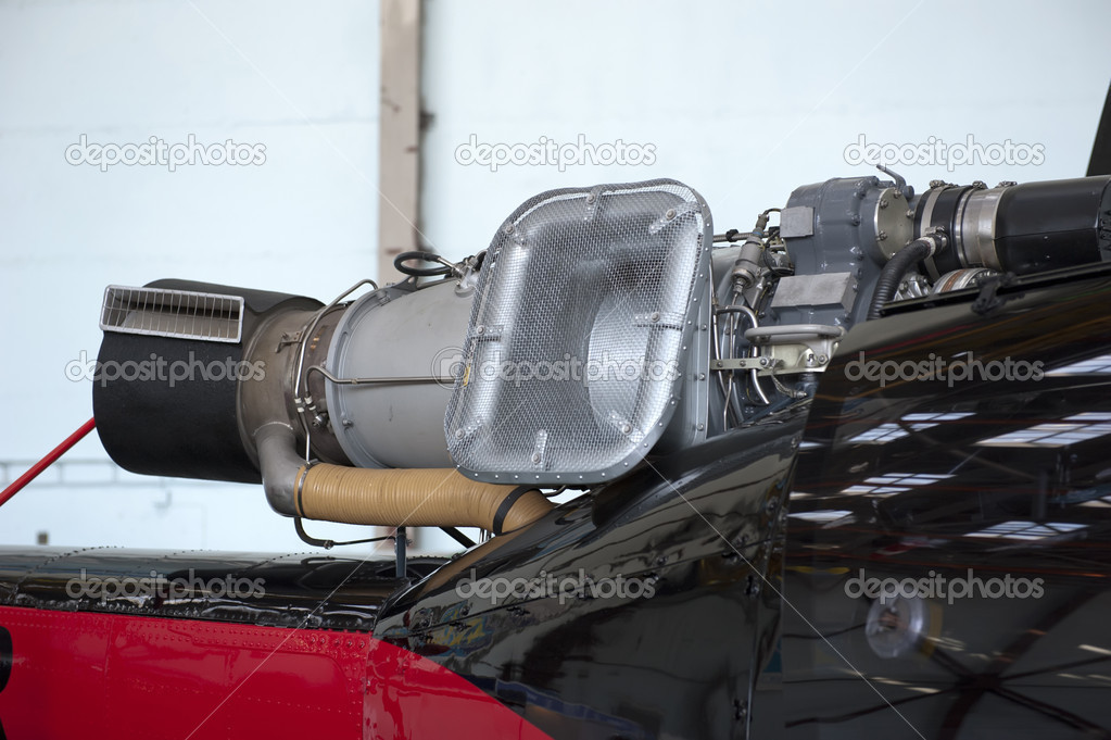 Output device of the helicopter engine on a light background closeup — Stock Photo #13846051