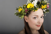 Girl with a wreath of flowers — Stock Photo
