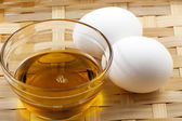 Egg and vegetable oil — Stock Photo