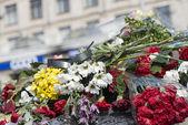 Flowers on the barricades of Kiev — Stock Photo