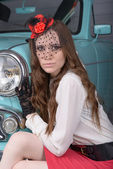 Girl in a hat and a car — Stock Photo