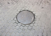 Manhole cover on the street. — Stok fotoğraf