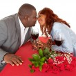 Foto Stock: African American Couple About to Kiss in Romantic Dinner