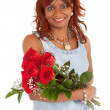Royalty-Free Stock Photo: Happy African American Woman  Posing with her Roses