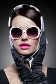 Gorgeous caucasian brunette with sunglasses — Stock Photo