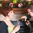 Happy Couple Sharing Some Wine at Christmas — Stock Photo