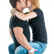Young Couple Kissing While He's Holding Her — Stock Photo
