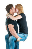 Young Couple Kissing While He's Holding Her — ストック写真