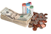 Stack of USA Currency and Rolls of Coins — Stock Photo